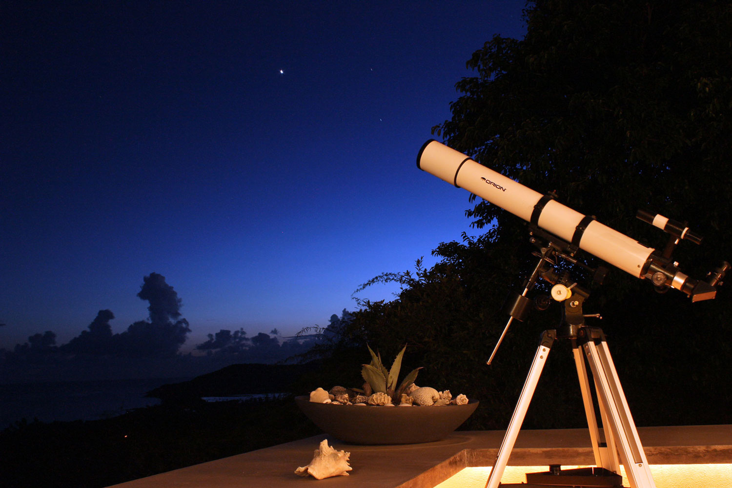 Telescope on deck at night